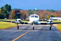 Twin Engine Aircraft Taking Off From Mena Arkansas Airport in Autumn