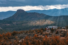 Thumb Butte and Cabin Home in Fall Colored Trees